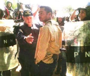 Delmer Omar Godoy Guifarro,  policía infiltrado que levnataba perfiles en la manifestación universitaria